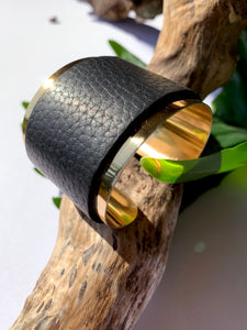 brass cuff with motorcycle leather accent