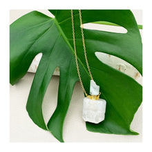 Load image into Gallery viewer, essential oil vial. a beautiful white geode crystal with a geode top. on a gold plated chain. a gorgeous pendant.