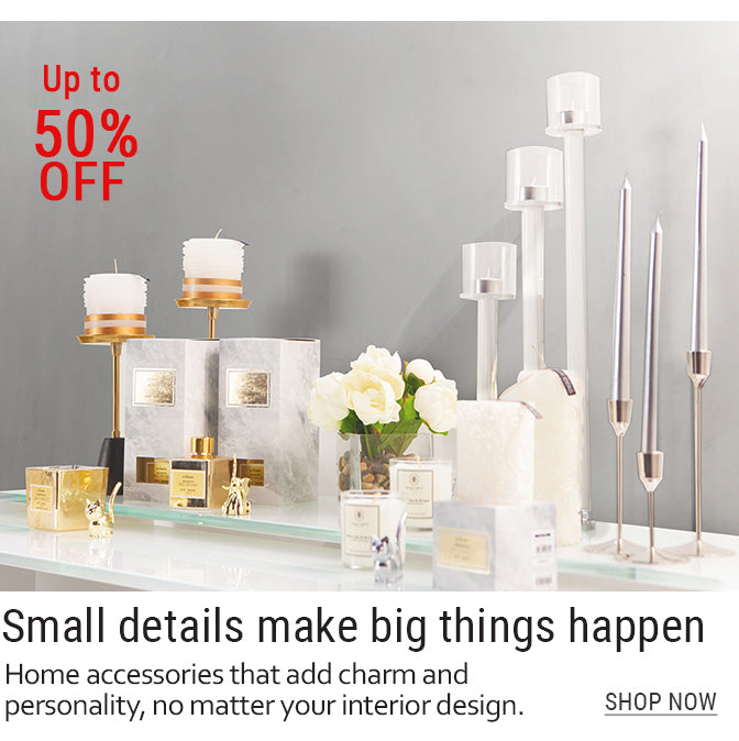 11-Elegant_candles_candle_holders_and_fragrances_on_white_table_top.jpg