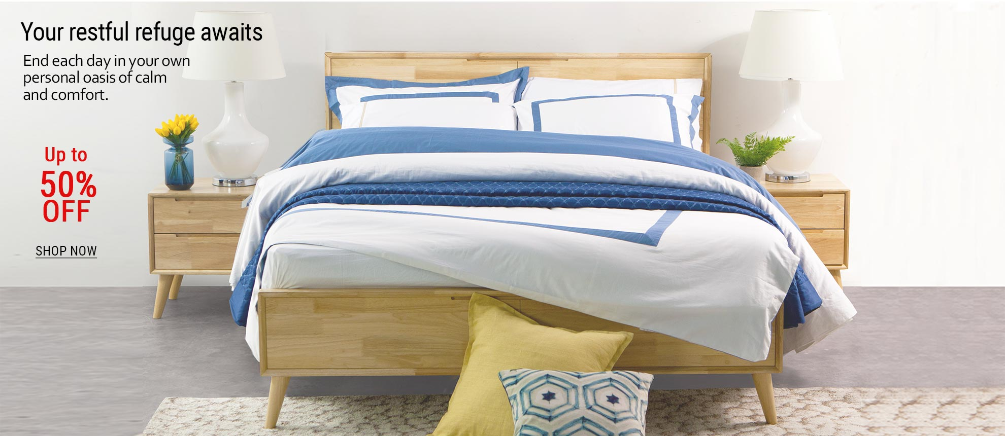 08-Scandinavian inspired bedroom with wooden bedframe white and blue linens and side tables.jpg