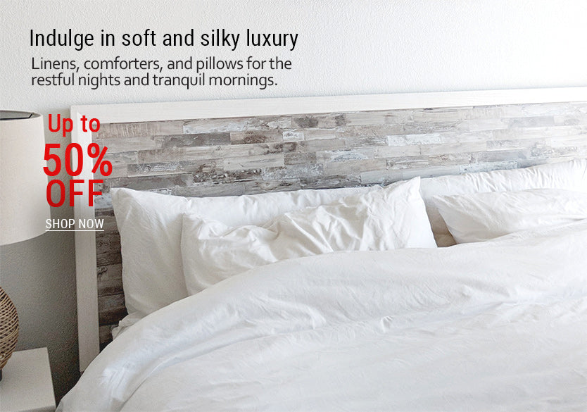 14_-_Close_up_of_a_bed_with_soft_linens_pillows_and_comforter