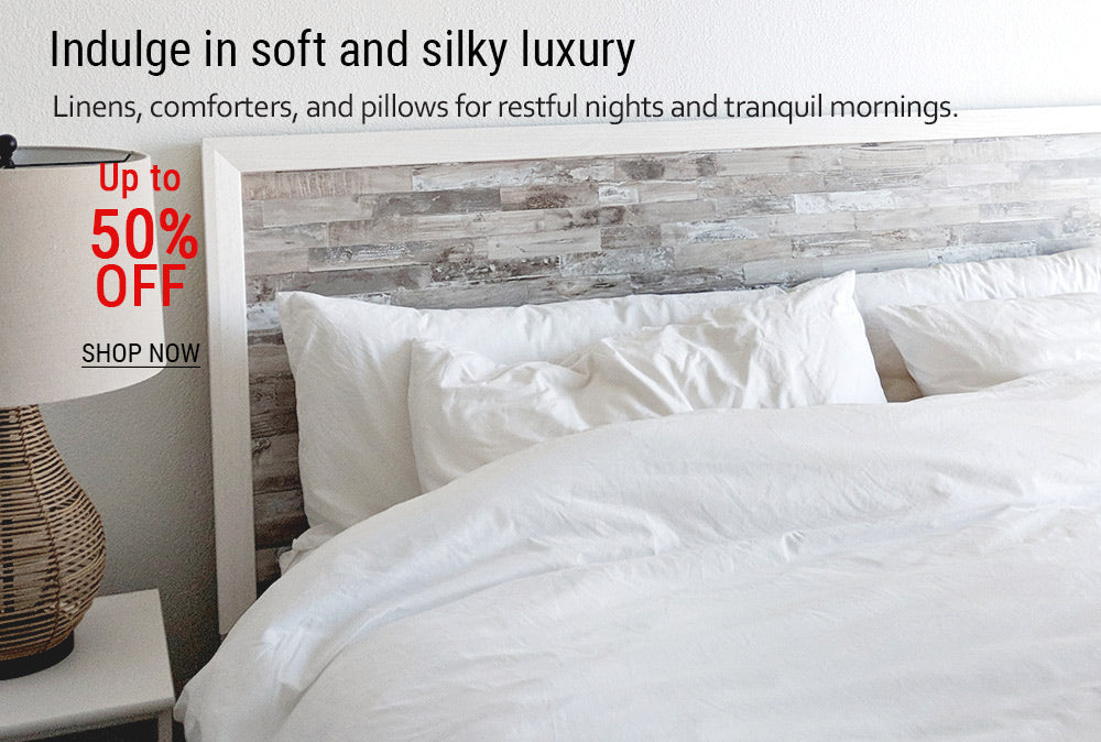 18-Close_up_of_a_bed_with_soft_linens_pillows_and_comforter