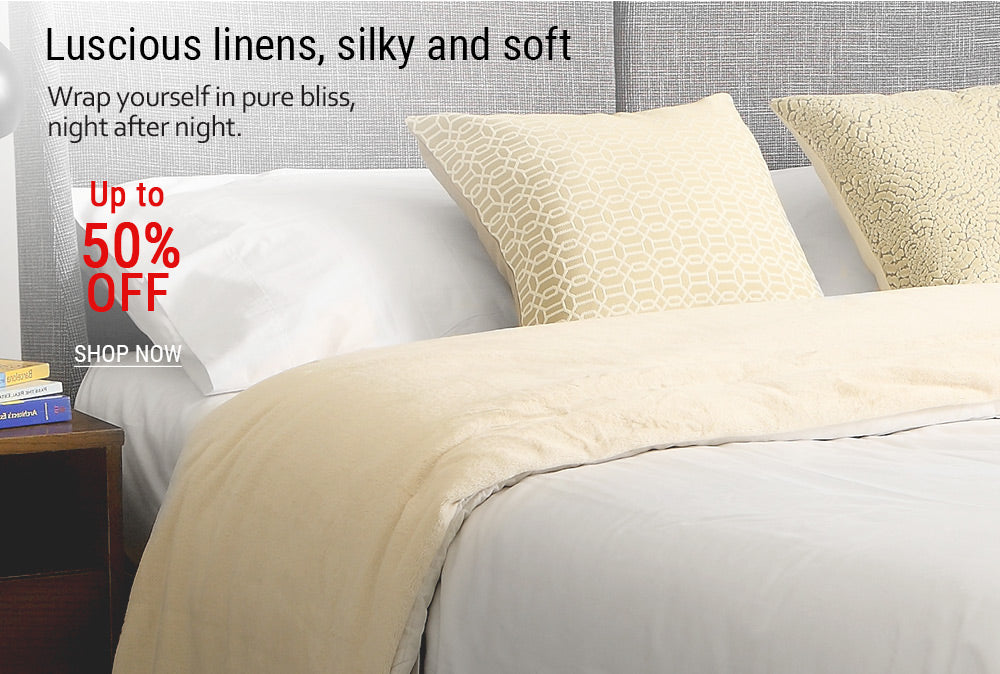 14-Close up of a comfortable bed with neutral colored linens