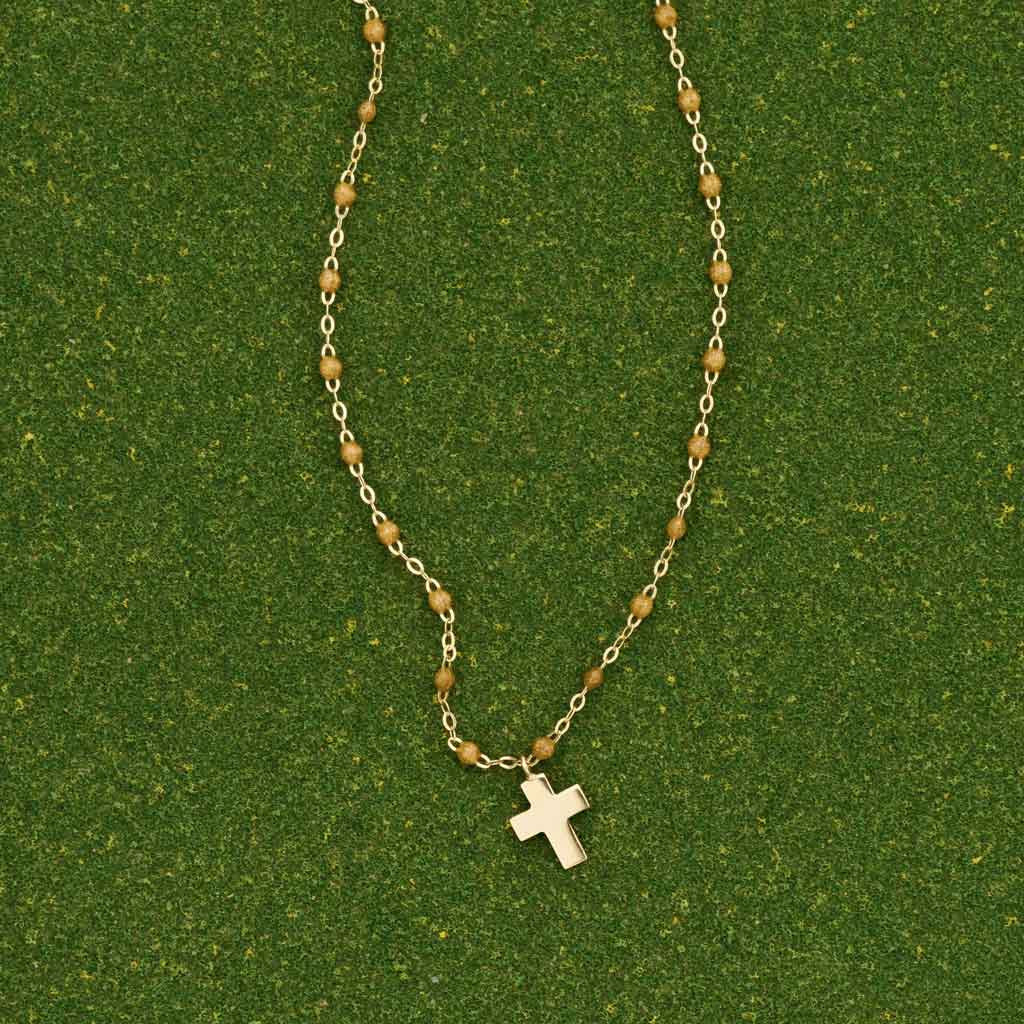 Gold Dangling Cross Necklace by Gigi Clozeau