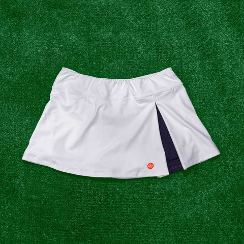 Kelly Skort - white/navy pleat w/orange logo