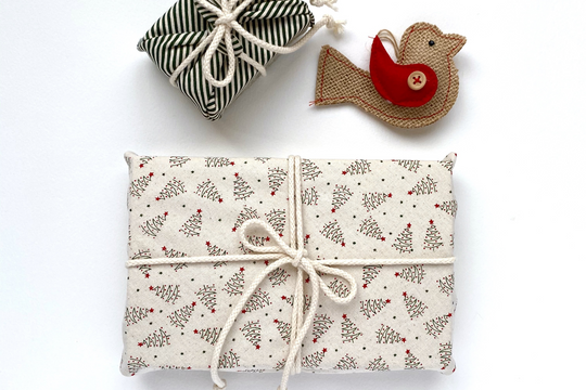 Christmas presents wrapped in reusable gift wrap, made in New Zealand by Wrapper's Delight.