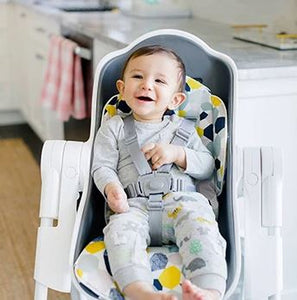 Baby using Oribel Cocoon High Chair Seat Liner