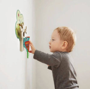 Child using Oribel VertiPlay Busy Woodpecker Knocker