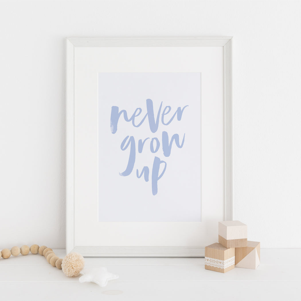 never grow up nursery print in blue