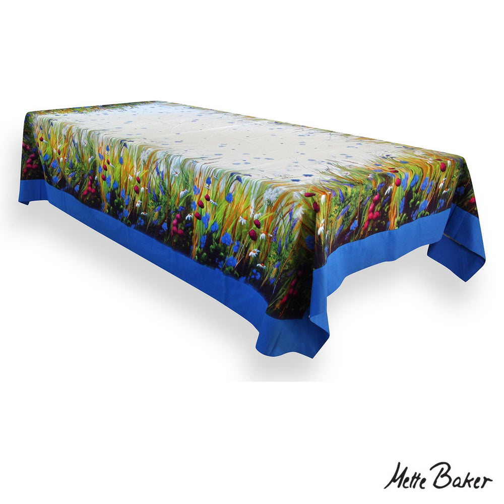 Tablecloth with blue trim and wildflowers