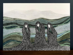 Macbeth Weird Sisters on the moorland image in black frame with blue wall background, standing on a wooden surface.