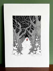 Red Riding Hood giclée print with handpainted watercolour detail in red, standing on wooden surface with green wall behind.