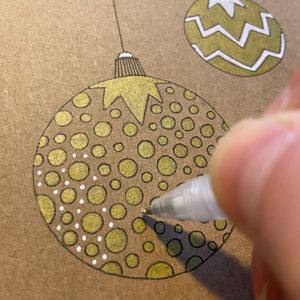 Gold, fineliner and white gel pen bauble on kraft card.
