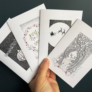 Christmas cards with fineliner illustrations.