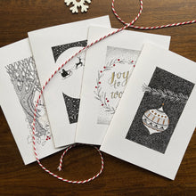 Load image into Gallery viewer, Christmas cards with fineliner illustrations and handpainted details on a wooden background.