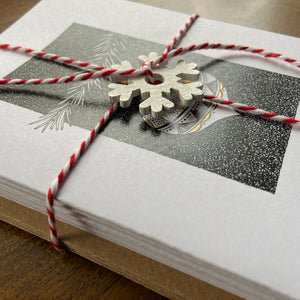 Christmas card pack close up with festive twine.