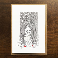 Load image into Gallery viewer, Christmas card with deer and forest illustration. SIlver gouache and red watercolour detail.