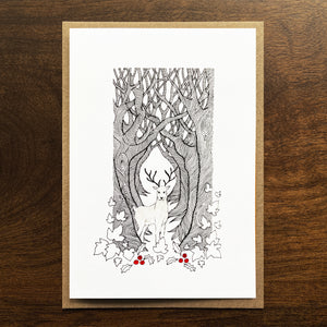 Christmas card with deer and forest illustration. SIlver gouache and red watercolour detail.