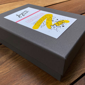Doodler's Art Set grey gift box with label on wooden background.