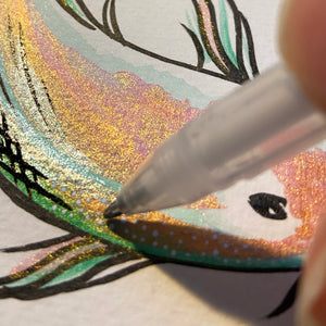 Close up of metallic koi painting and white gel pen details.
