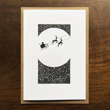 Load image into Gallery viewer, Christmas card with Santa silhouette and moon illustration. SIlver gouache detail.