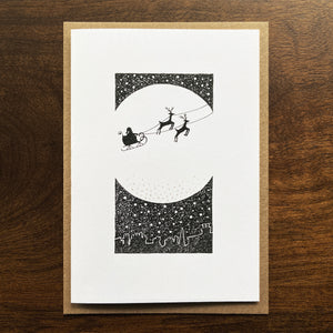 Christmas card with Santa silhouette and moon illustration. SIlver gouache detail.