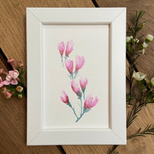 Load image into Gallery viewer, Pink blossom painting in white frame with delicate waxflowers on a wooden background.