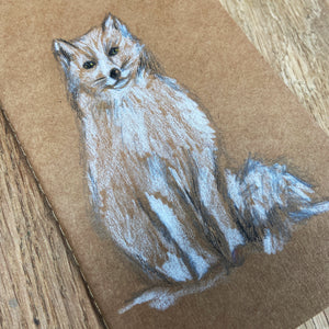 Winter art set white arctic fox drawing on kraft notebook.