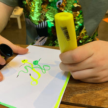 Load image into Gallery viewer, Child using yellow highlighter to doodle.