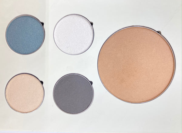 Delight Palette Collection includes Allure Pressed Matte Bronzer and Contour ( pale/light skin tones or Natural ), Crystal Pressed Eye Colour (shimmery white) Whisper Pressed Eye Colour (demi-matte ivory cream)  Eve Pressed Eye Colour (smoky teal) Ashen Pressed Eye Colour (Matte charcoal) and a mirror on the inside.