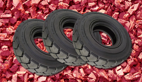 tires on a bed of red mulch