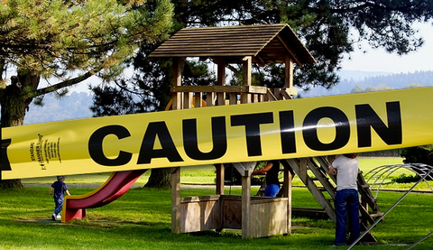caution tape across a playground