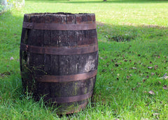 wooden barrel in the garden for collecting rainwater