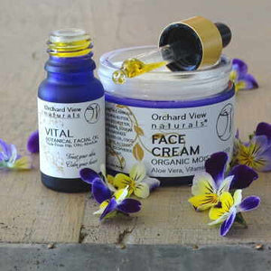 OV naturals Skincare, Vital Facial Oil & Organic Face Cream, with viola flowers purple & golden.
