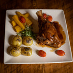 Braised Lamb Shank Orange and Garlic Sauce