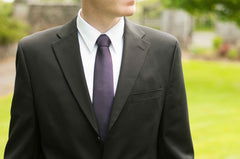 Groom wearing a Patrician Purple Tie and black suit