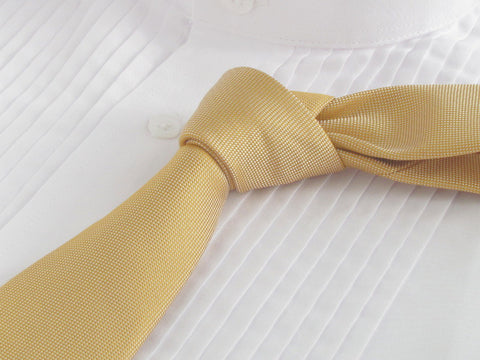 golden yellow tie with tuxedo shirt