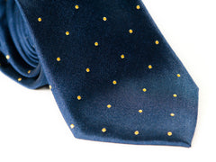 Closeup photo of Navy Blue with yellow polka dots rolled tie