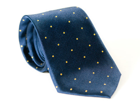 Navy Blue with yellow polka dots necktie rolled up