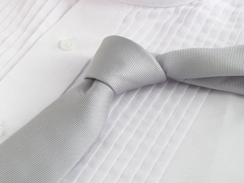 silver color necktie with tuxedo shirt