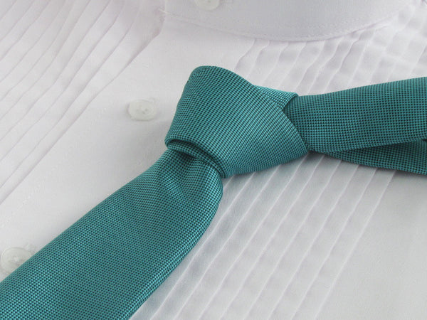 turquoise color tie with white tuxedo shirt