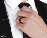 Man in Suit Wearing Titanium Ring