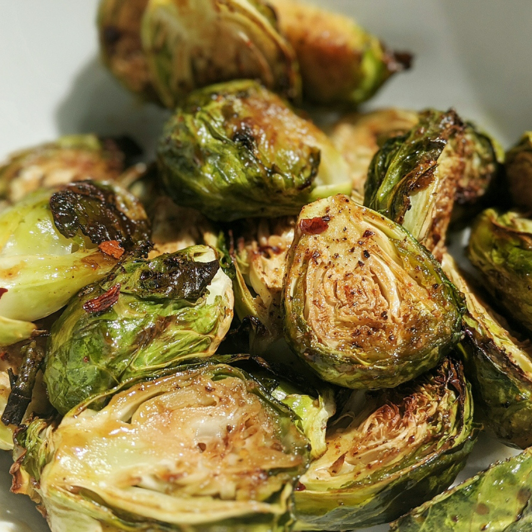 Brussel sprouts that have been baked. The edges of the sprouts are wilted and darkened.