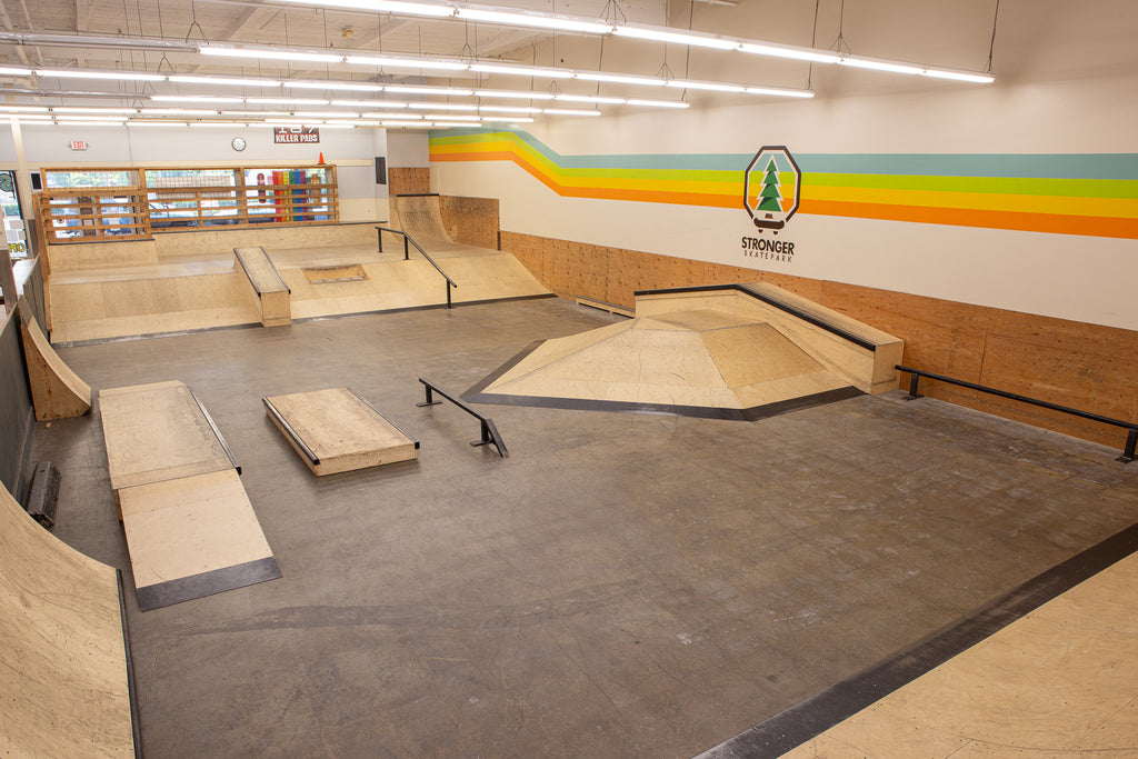 Overview of wooden skatepark featuring various obstacles.