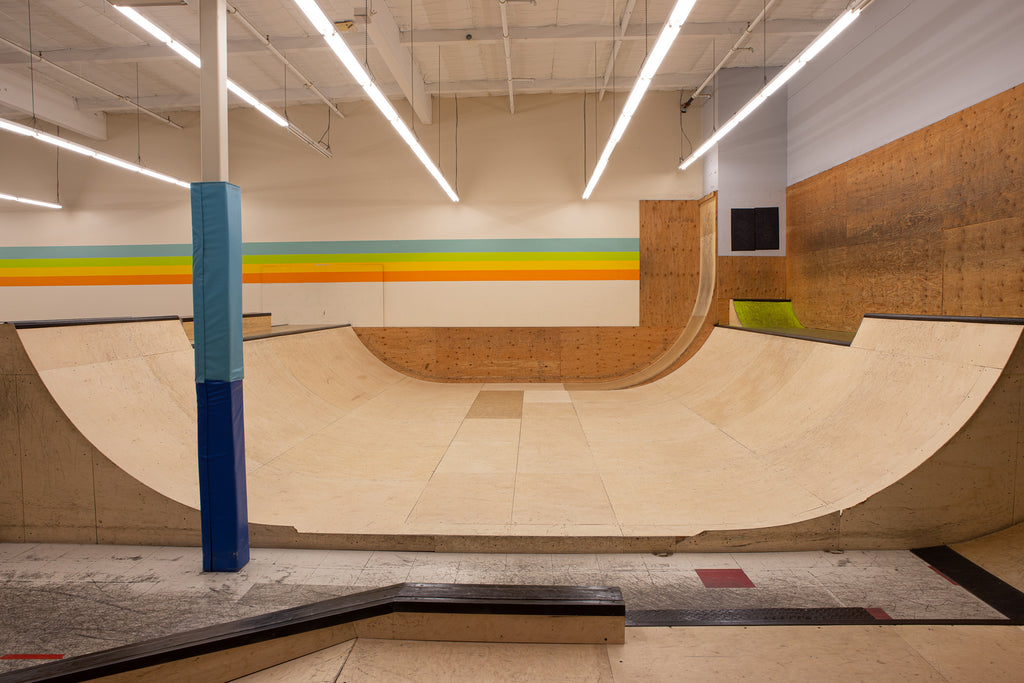 A wooden half pipe. 5 Feet tall in the foreground, 4 feet tall in the back.