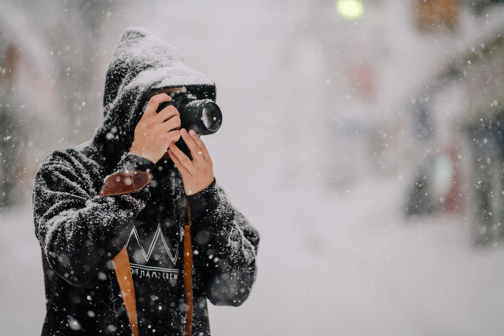 Travel Photographer with Leather Camera Strap in Snow Japan