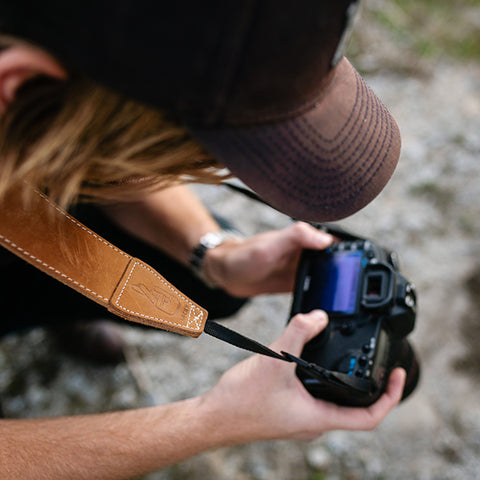 A hand made leather camera strap in use