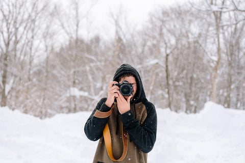 Male Photographer in Snow with Leather Camera Strap