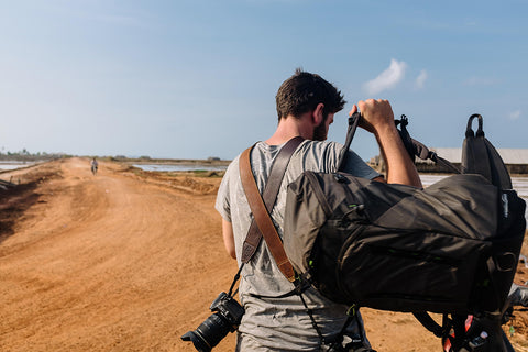 Male Adventure Photographer with Leather Camera Straps