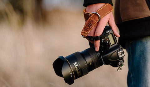 Photographers Hand with Leather Wrist Strap